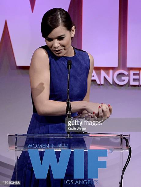 Actress Hailee Steinfeld accepts The 2013 Women In Film Max Mara Face of the Future Award onstage during Women In Film's 2013 Crystal Lucy Awards at...