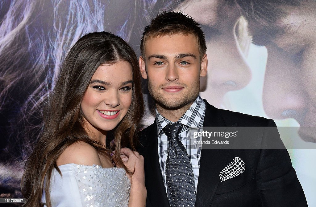 Actress Hailee Steinfeld (L) and actor Douglas Booth arrive at the world premiere of 'Romeo and Juliet' at the ArcLight Hollywood on September 24, 2013 in Hollywood, California.