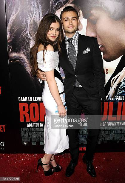 Actress Hailee Steinfeld and actor Douglas Booth attend the premiere of 'Romeo And Juliet' at ArcLight Hollywood on September 24 2013 in Hollywood...