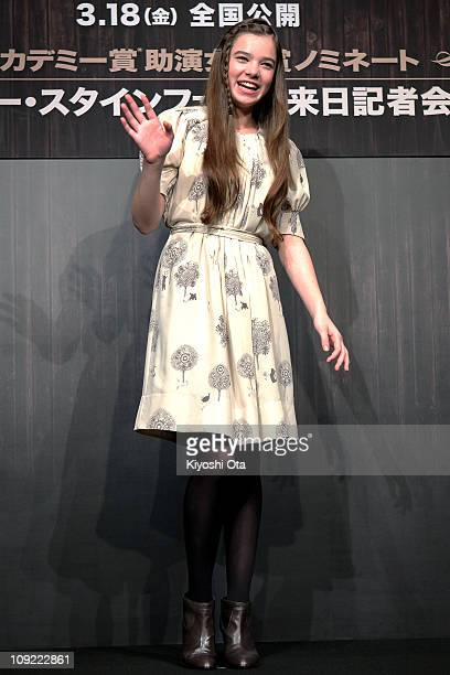 Actress Hailee Steinfeld waves during a press conference for 'True Grit' at The Peninsula Tokyo on February 17 2011 in Tokyo Japan The film will open...