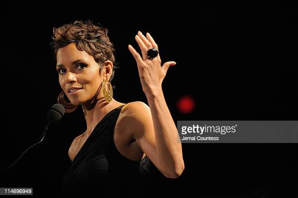 Actress Halle Berry accepts her award onstage during the 2011 FiFi Awards at The Tent at Lincoln Center on May 25, 2011 in New York City.
