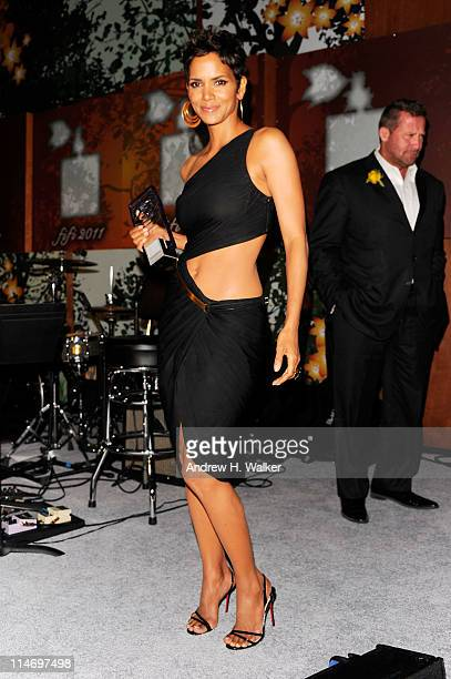Actress Halle Berry accepts her award onstage during the 2011 FiFi Awards at The Tent at Lincoln Center on May 25 2011 in New York City