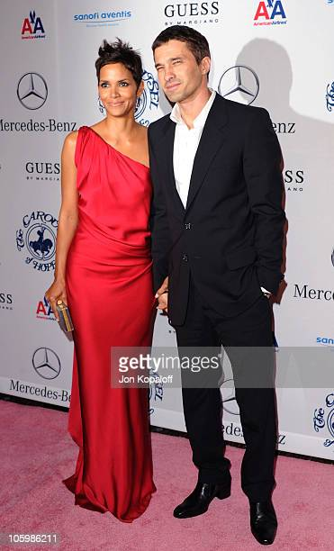 Actress Halle Berry and actor Olivier Martinez arrive at the 32nd Anniversary Carousel Of Hope Ball at The Beverly Hilton hotel on October 23, 2010...