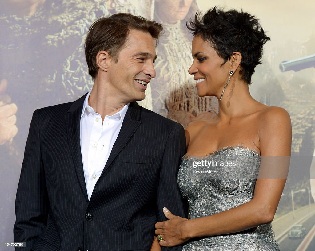Actress Halle Berry (R) and actor Olivier Martinez arrive at the premiere of Warner Bros. Pictures' 'Cloud Atlas' at the Chinese Theatre on October 24, 2012 in Los Angeles, California.