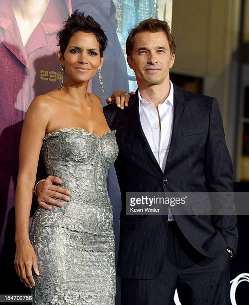 Actress Halle Berry and actor Olivier Martinez arrive at the premiere of Warner Bros Pictures' Cloud Atlas at the Chinese Theatre on October 24 2012...