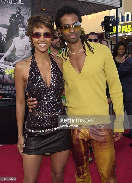 Actress Halle Berry and her husband Eric Benet arrive at the world premiere of Warner Bros'' Swordfish June 4 2001 at the Mann Village Theatre in...