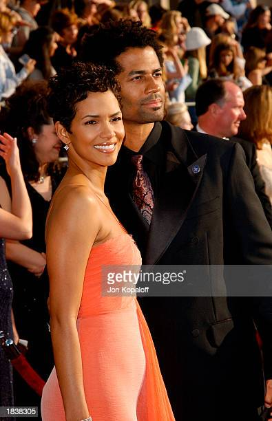 Actress Halle Berry and husband, musician Eric Benet, attend the 9th Annual Screen Actors Guild Awards at the Shrine Auditorium on March 9, 2003 in...