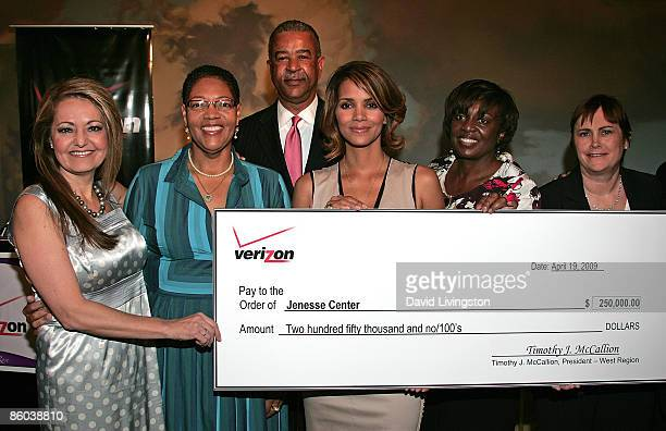 Actress Halle Berry and Jenesse Center executive director Karen Earl attend the Jenesse Silver Rose Gala and Auction at the Beverly Hills Hotel on...