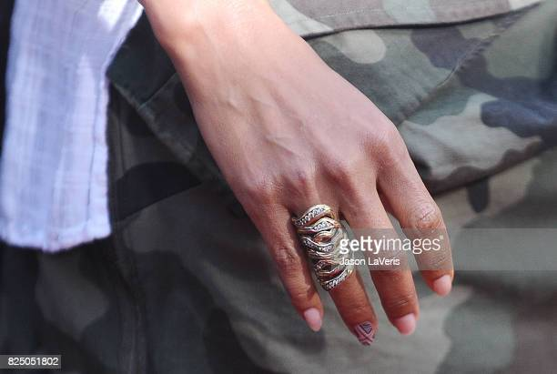 Actress Halle Berry jewelry and nail detail attends the premiere of Kidnap at ArcLight Hollywood on July 31 2017 in Hollywood California