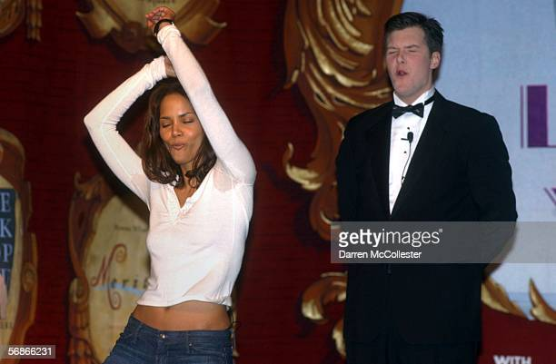 Actress Halle Berry performs a dance while presenter John P Blickstead looks on during the Hasty Pudding Theatrical's Woman of the Year ceremonies at...