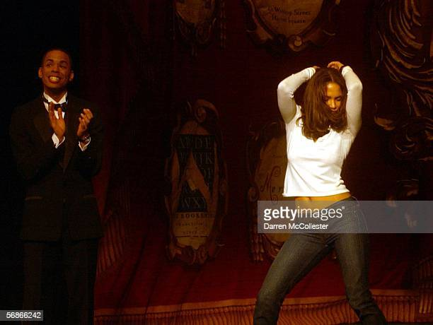 Actress Halle Berry performs a dance while presenter Peter Dodd looks on during the Hasty Pudding Theatrical's Woman of the Year ceremonies at...