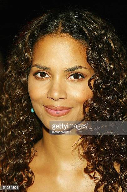 """Actress Halle Berry poses at the after-party for the premiere of Warner Bros. Pictures """"Catwoman"""" at the Cinerama Dome on July 19, 2004 in Los..."""