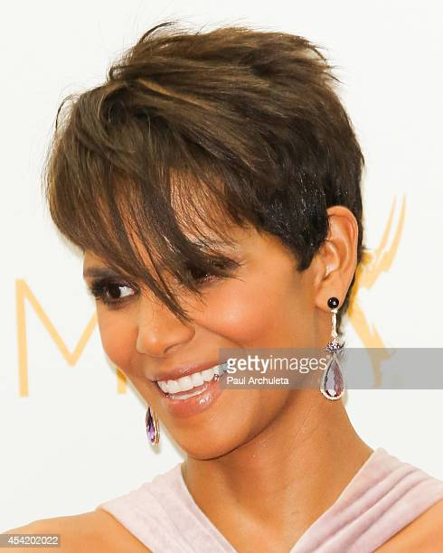 Actress Halle Berry poses for photos in the press room at the 66th annual Primetime Emmy Awards at Nokia Theatre LA Live on August 25 2014 in Los...