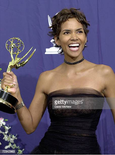 Actress Halle Berry poses with her award for 'Lead Actress in a Miniseries or a Movie' in 'Dorothy Dandridge' backstage at the 52nd Annual Primetime...
