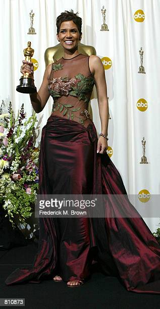 Actress Halle Berry poses with her Best Actress in a Leading Role Oscar for Monster's Ball backstage during the 74th Annual Academy Awards March 24...