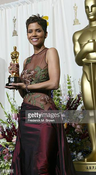 Actress Halle Berry poses with her Best Actress in a Leading Role Award for 'Monster's Ball' backstage during the 74th Annual Academy Awards March 24...