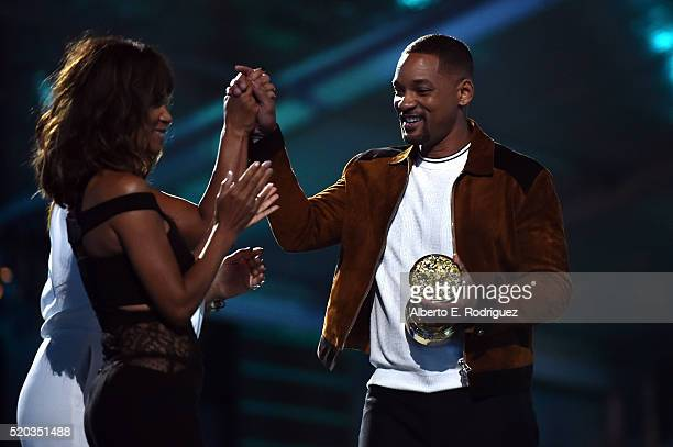 Actress Halle Berry presents honoree Will Smith with the Generation Award onstage during the 2016 MTV Movie Awards at Warner Bros Studios on April 9...