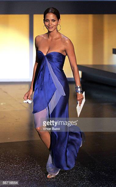 Actress Halle Berry presents the award for Outstanding Actor in a Movie or Mini Series onstage at the 57th Annual Emmy Awards held at the Shrine...