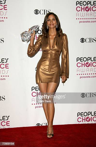 Actress Halle Berry winner of the Favorite Female Action Star award poses in the press room during the 33rd Annual People's Choice Awards held at the...