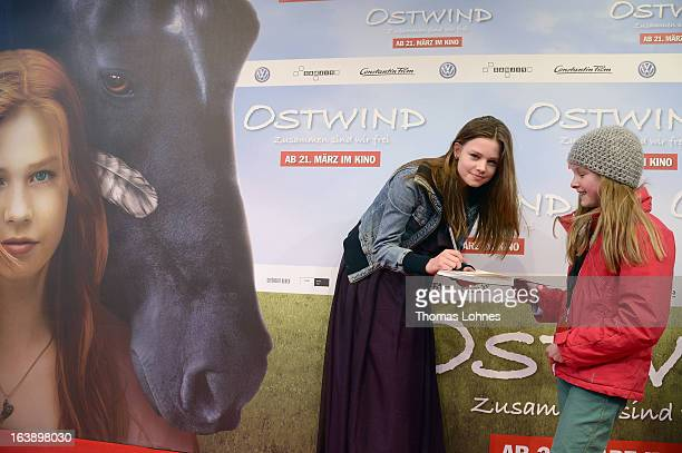 Actress Hanna Binke writes before the premiere of the film Ostwind autographs on March 17 2013 in Frankfurt am Main Germany The family film portrays...
