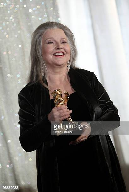 Actress Hanna Schygulla holds up her Honorary Golden Bear for lifetime achievement she received at the 60th Berlinale International Film Festival at...