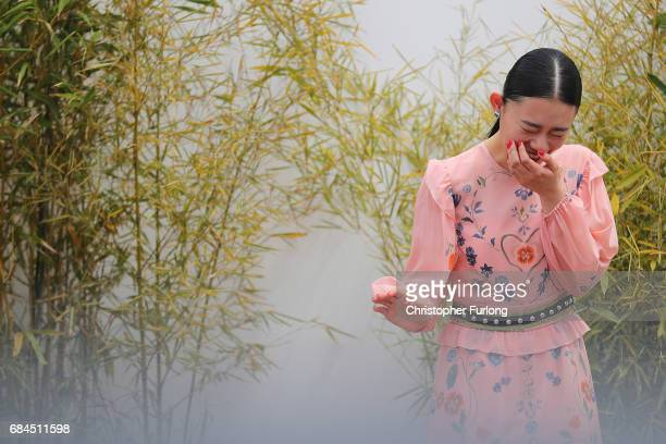 Actress Hanna Sugisaki shyly giggles as she arrives to attend the 'Blade Of The Immortal ' press conference on the Boulevard de la Croisette during...
