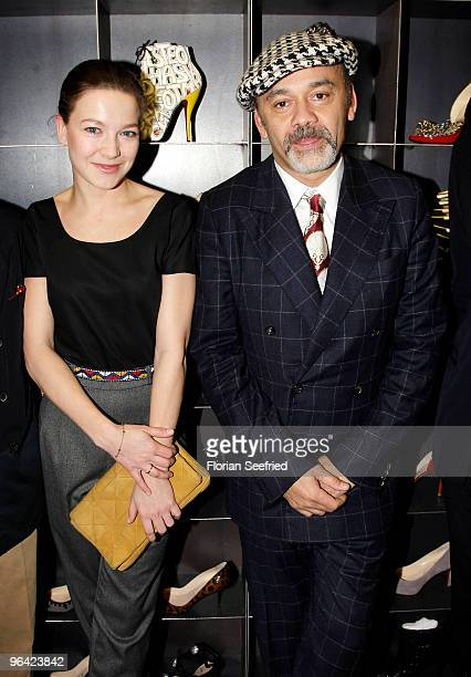 Actress Hannah Herzsprung and shoe Designer Christian Louboutin attend the 'Christian Louboutin' cocktail reception at The Corner Shop on February 4...