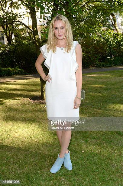 Actress Hannah New attends the Club Monaco Garden Party hosted by Quentin Jones, Clara Paget and Annie Morris in Eaton Square on July 3, 2014 in...