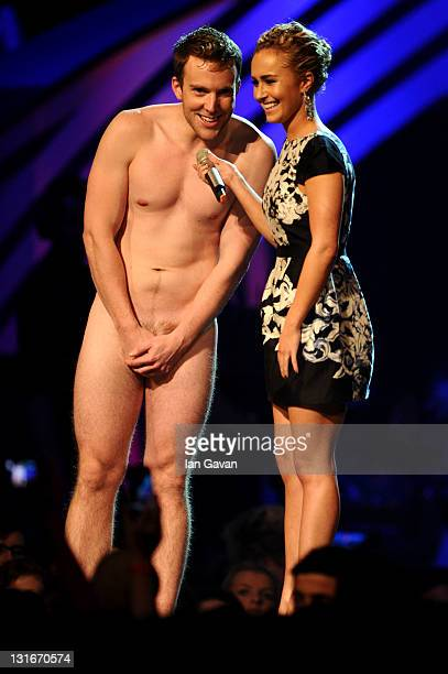 Actress Hayden Panettiere and naked guest perform onstage during the MTV Europe Music Awards 2011 live show at at the Odyssey Arena on November 6...