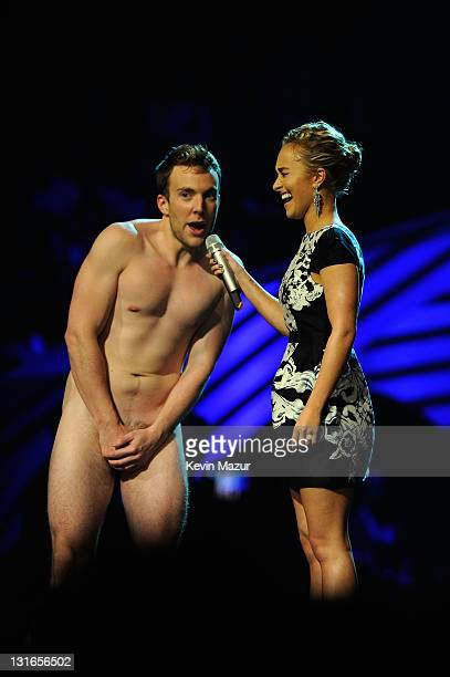 Actress Hayden Panettiere and naked guest speak onstage during the MTV Europe Music Awards 2011 live show at at the Odyssey Arena on November 6 2011...