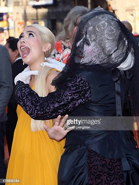 Actress Hayley Kiyoko and actor Tom Fitzpatrick dressed as the Bride In Black attend the premiere of Focus Features' 'Insidious Chapter 3' at the TCL...