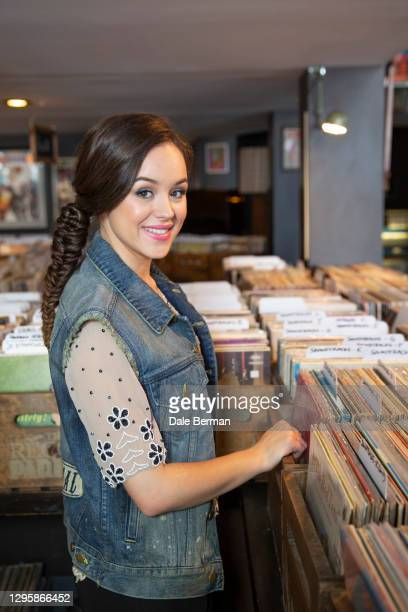 Actress Hayley Orrantia poses for a portrait at a record store with a record turn table on October 26, 2014 in Hollywood California.