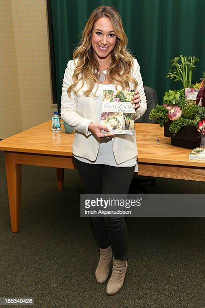 Actress Haylie Duff poses before signing copies of her new book 'The Real Girl's Kitchen' at Barnes Noble Booksellers on October 18 2013 in Glendale...