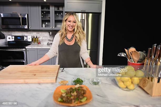 Actress Haylie Duff prepares food on stage during the Grand Tasting presented by ShopRite featuring Samsung Culinary Demonstrations presented by...