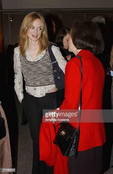 Actress Heather Graham chats with actress Susan Kohner at the Jack Oakie Lecture on Comedy in Film featuring Paul and Chris Weitz at the Academy of...