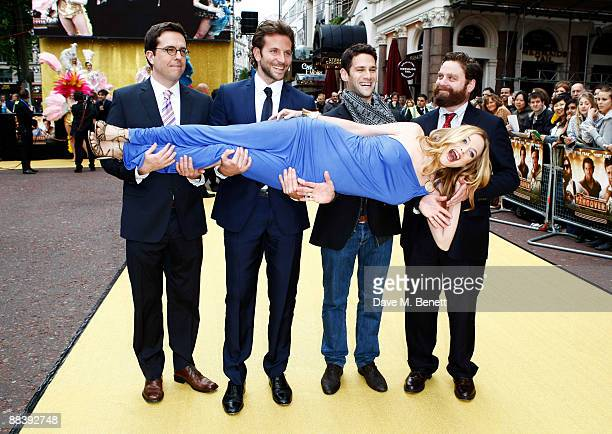 Actress Heather Graham is carried by actors Ed Helms Bradley Cooper Justin Bartha and Zach Galifianakis as they attend 'The Hangover' film premiere...