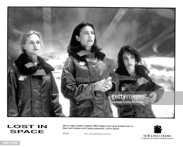 Actress Heather Graham Mimi Rogers and Lacey Chabert on set of the New Line Cinema movie ' Lost in Space ' circa 1998