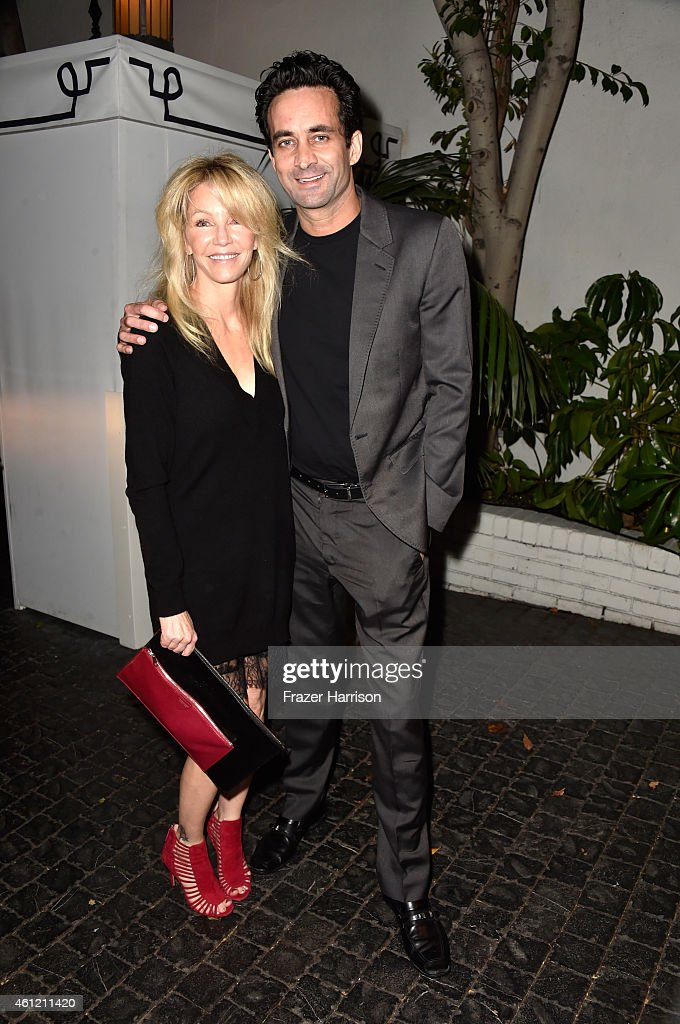 Actress Heather Locklear (L) and Dr. Marc Mani attend the W Magazine celebration of the 'Best Performances' Portfolio and The Golden Globes with Cadillac and Dom Perignon at Chateau Marmont on January 8, 2015 in Los Angeles, California.
