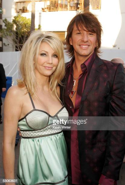 Actress Heather Locklear and her husband musician Richie Sambora arrive at the premiere of The Perfect Man at Universal Studios Cinema on June 13...