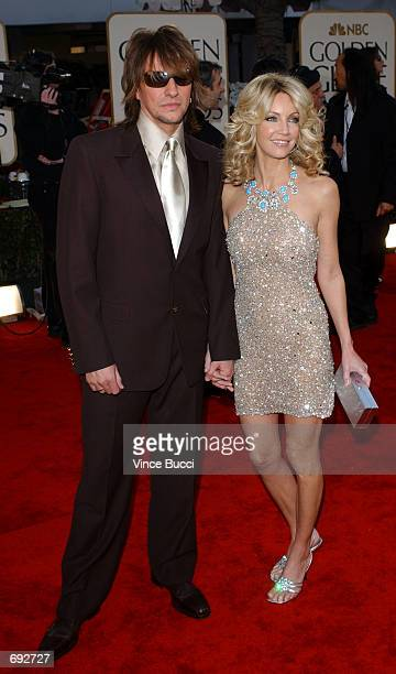 Actress Heather Locklear and her husband musician Richie Sambora attend the 59th Annual Golden Globe Awards at the Beverly Hilton Hotel January 20...