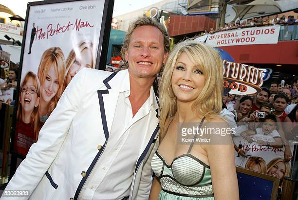 Actress Heather Locklear and tv personality Carson Kressley arrive at the premiere of The Perfect Man at Universal Studios Cinema on June 13 2005 in...