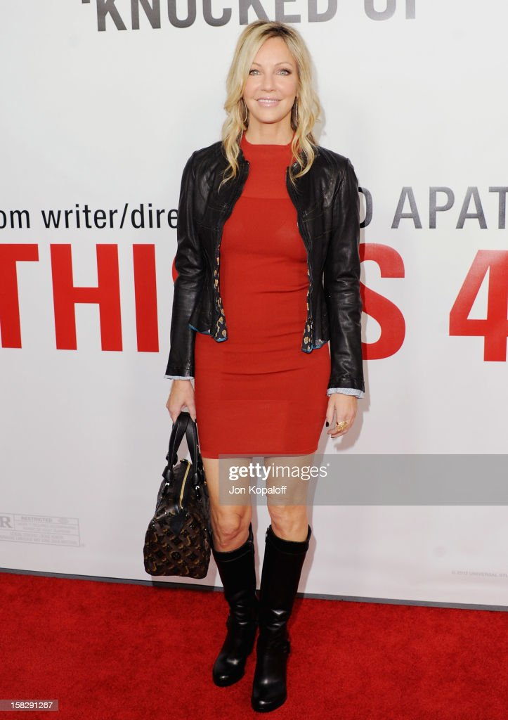 Actress Heather Locklear arrives at the Los Angeles Premiere 'This Is 40' at Grauman's Chinese Theatre on December 12, 2012 in Hollywood, California.