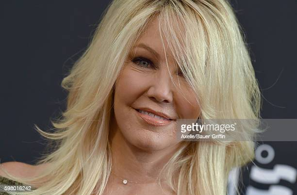 Actress Heather Locklear arrives at the screening of 'Too Close to Home' at The Paley Center for Media on August 16 2016 in Beverly Hills California