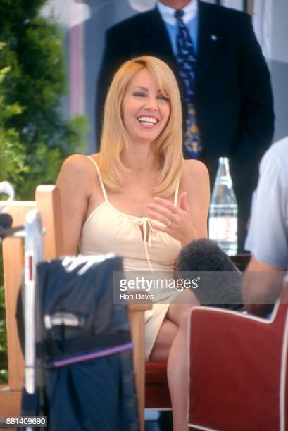 Actress Heather Locklear sits at a table during a photocall Of L'Oréal on May 22 1999 in Cannes France