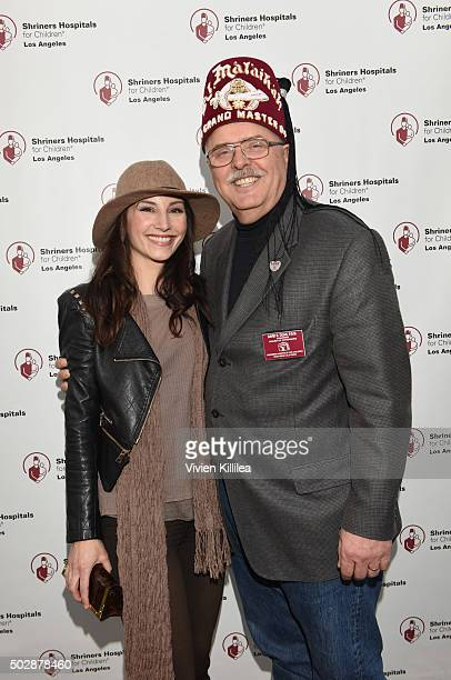 Actress Heather McComb and Shriners Hospitals forChildren Los Angeles board chairman David R Doan attend Celebrities Decorate The Shriners Rose...