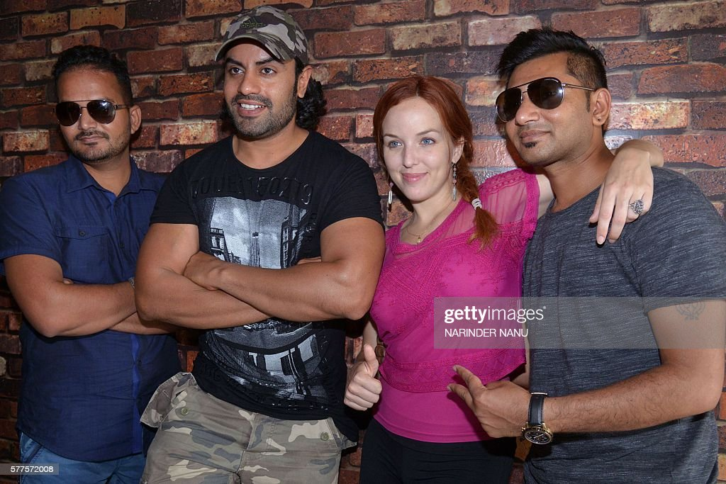 US actress Heather Sims Indian actors Aman Dhaliwal Sunny Boparai and Baaz Lalia pose during a promotional event for the forthcoming Punjabi film...