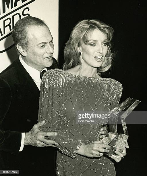 Actress Heather Thomas and actor Tony Curtis attending First Annual Stuntman's Awards Show on February 2 1985 at KABC TV Studios in Los Angeles...