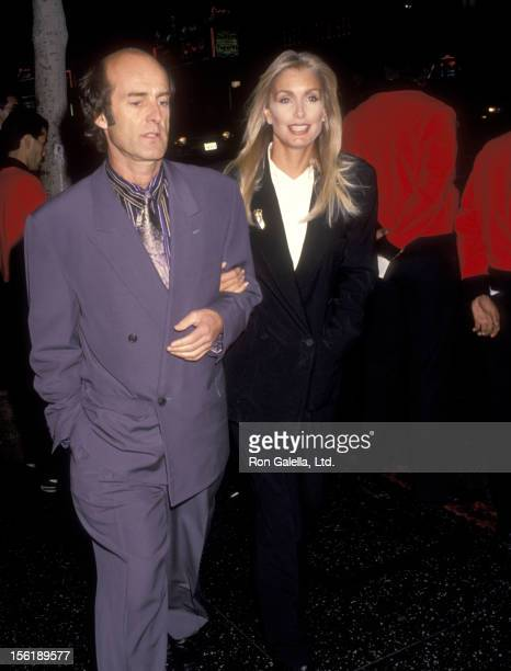 Actress Heather Thomas and date Harry M Brittenham attend the 'Medicine Man' Hollywood Premiere on February 5 1992 at El Capitan Theatre in Hollywood...