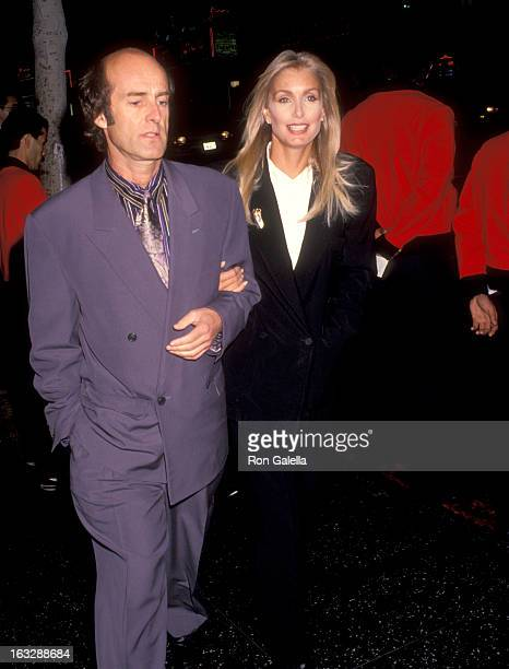Actress Heather Thomas and date Harry M Brittenham attend the Medicine Man Hollywood Premiere on February 5 1992 at El Capitan Theatre in Hollywood...
