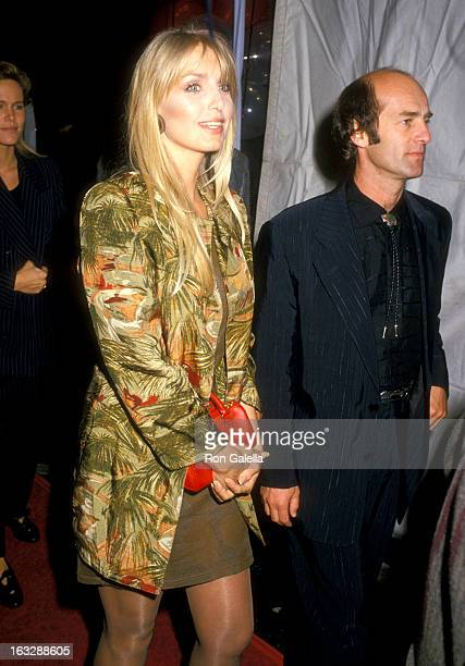 Actress Heather Thomas and date Harry M Brittenham attend the Sweet Hearts Dance Westwood Premiere on September 18 1988 at Avco Center Cinemas in...